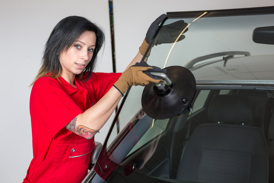 woman repairing a windshield